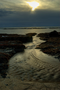© Joseph Dougherty. All rights reserved.   Tidal channel at sunset on the California coast.