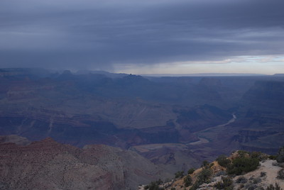 © Joseph Dougherty.  All rights reserved.   The Grand Canyon beneath somber skies, with a thin ribbon of Colorado River at its base.