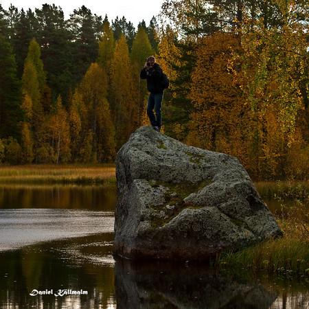 Photographer on big rock