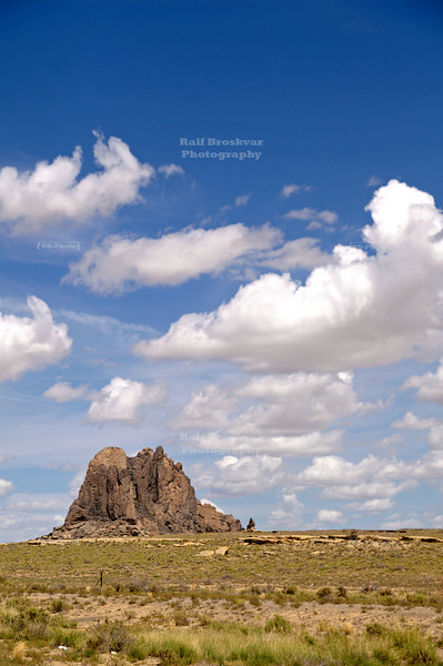 Beautiful clouds- and landscape with rock formation alongside former route 666 in New Mexico, USA