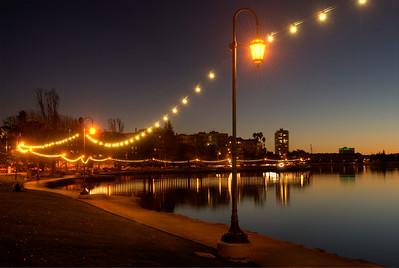 © Joseph Dougherty.  All rights reserved.   String of Pearls, lights surrounding Lake Merritt at dusk; Oakland, Alameda County, California.