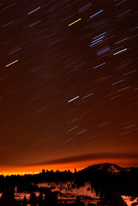 © Joseph Dougherty. All rights reserved.   Star trails over the Sierra Nevada, with the glow of Carson City, NV hiding behind the mountains.  20 minute exposure at 1:00am on a moonless night.