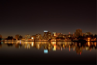 © Joseph Dougherty.  All rights reserved.   Oakland city lights at night, reflected in Lake Merritt; Oakland, Alameda County, California.