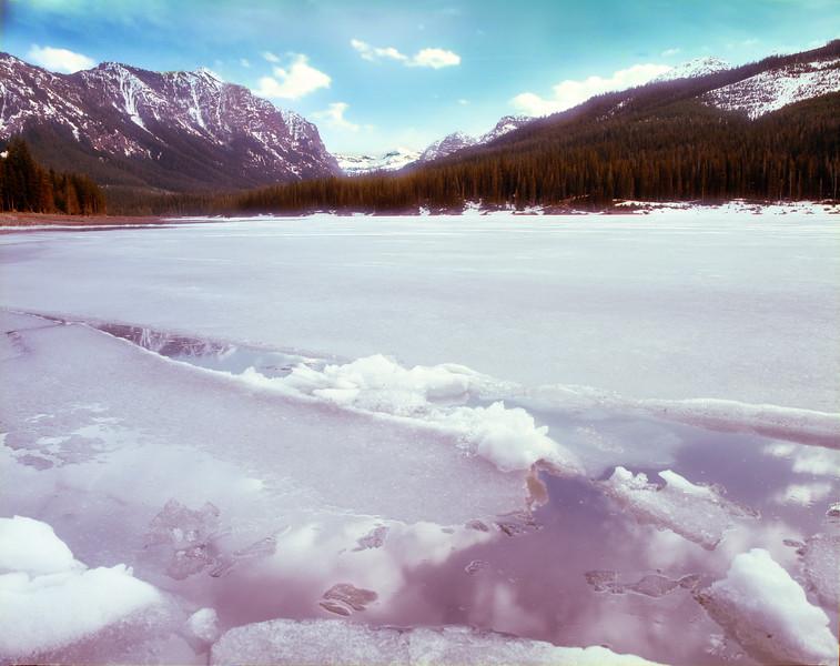 Hyalite Reservoir beginning to melt in spring.  near Bozeman, MT <br /> <br /> © Kirk Sagers