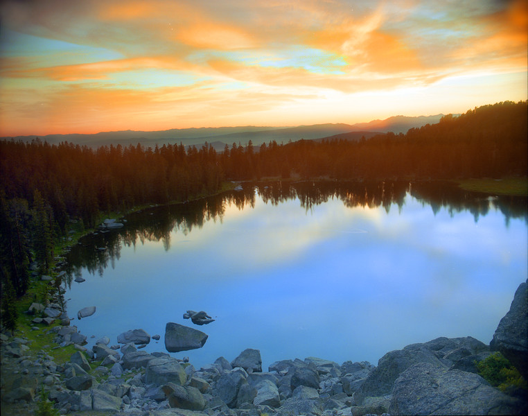 Looking out to the sunset from above Rainbow Lake in the Wind River Range.  Bridger Teton Wilderness, WY<br /> <br /> © Kirk Sagers
