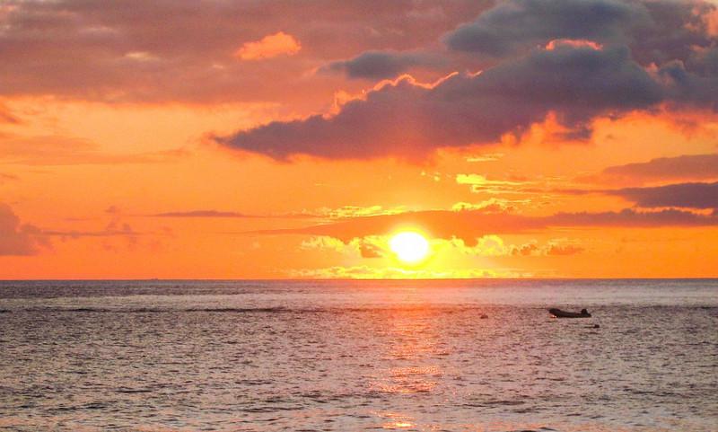Divers at sunset along Ka'anapali beach in Maui.