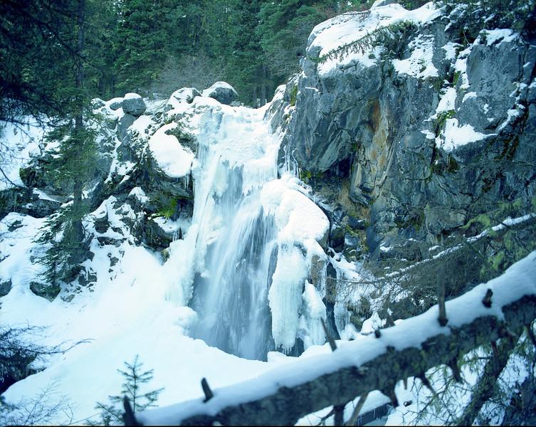 Pioneer Falls in winter.  Lee Metcalf Wilderness, MT<br /> <br /> © Kirk Sagers