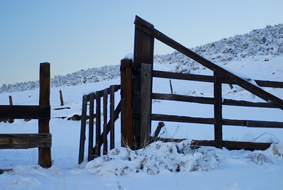 © Joseph Dougherty. All rights reserved.   Wooden corral fence in the snow.