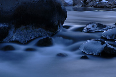© Joseph Dougherty. All rights reserved.   Ice caps cover exposed rocks along a cold mountain river. Truckee River in the eastern Sierra Nevada.