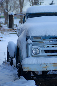 © Joseph Dougherty. All rights reserved.   Old truck under snow, on farm near Reno, Nevada.