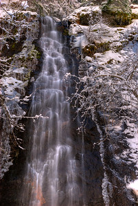 © Joseph Dougherty. All rights reserved.   Waterfall in winter, with trees crusted in snow; Sierra Nevada range; El Dorado County, CA.