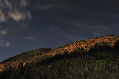 Near full moon, about 10 pm one night outside of Silverton CO, the moon glow illuminated the mountains.  September 2011