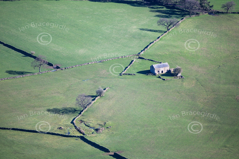 A small stone barn in the Derbyshire Peak District from the air.