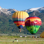 Balloons rising in front of Jackson Ski Resort, WY sunrise.