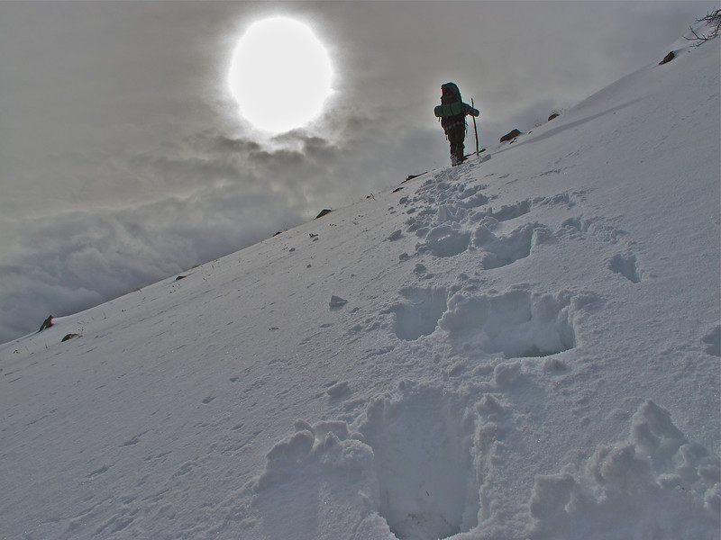 Snowy summit hiker