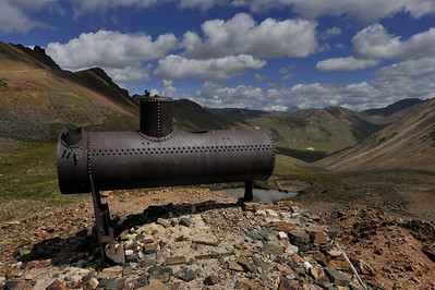 A iron, riveted boiler, above Silverton CO, about 12,600 feet, September 2011.  How did they get this up there?