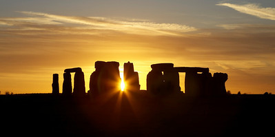 Stonehenge at sunset with sun shining through