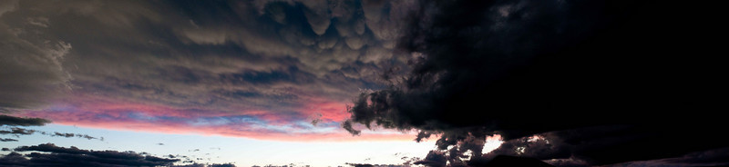 Panoramic of a storm that moved into the area over a sunset.