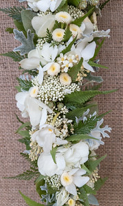 Chrysanthemum, kukui, babyʻs breath, palaʻā, dusty miller and dendrobium