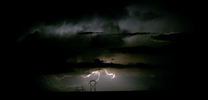 Low saturation lightning with power lines.
