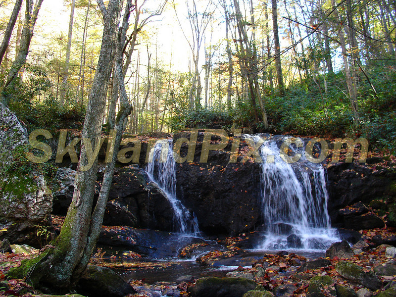 This waterfall is only about 8 feet high and is located in the Little Switzerland, NC area near the road that runs from Charlie Woody Mountain back toward Crabtree Creek Road.