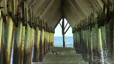 Not a good idea to swim under the pier.