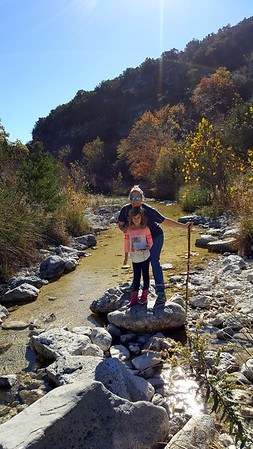 Laney and Deena posing on a rock by the river.