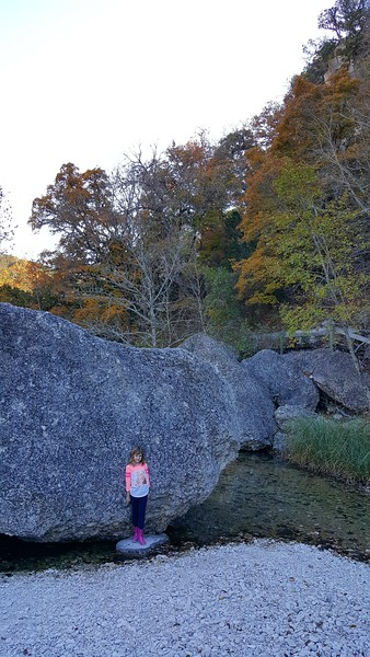 Laney looks tiny compared to the giant boulder.