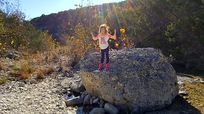 Laney poses on a giant boulder