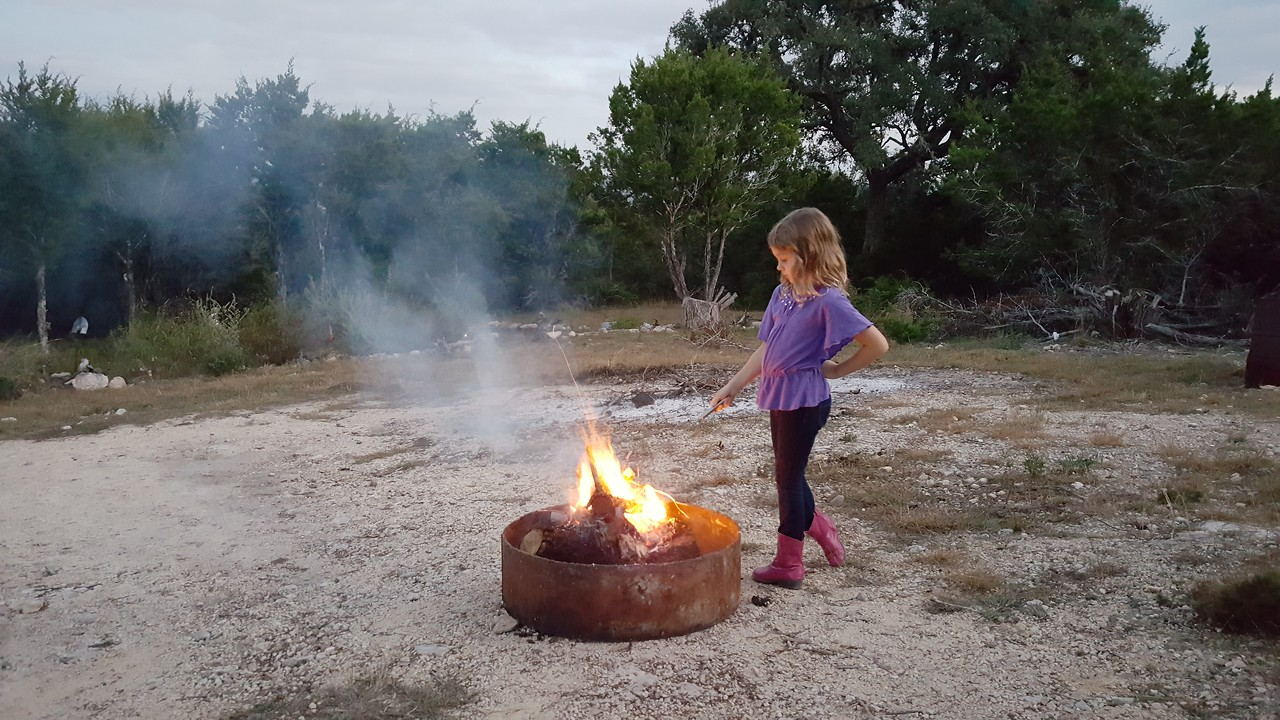 Laney messing with the fire at Nana's