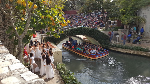 A river tour boat and dancers about to go on stage.