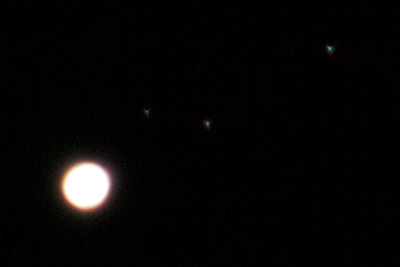 OK, this in not the moon, but it is Jupiter with three moons.