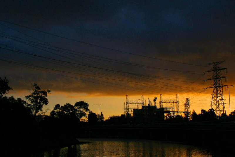 """The sun sets beautifully over the Richmond Electricity Substation. The bit of water that you can briefly see from the freeway is called """"Burnley Harbour"""". It's fractionally prettier up close than you might expect if you've only ever glimpsed it from the freeway."""