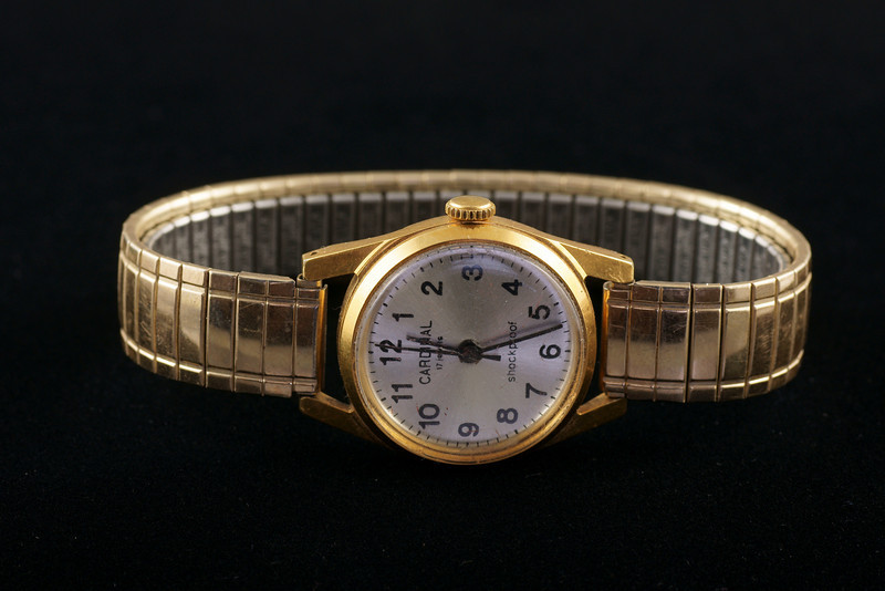 Gold watch on velvet.