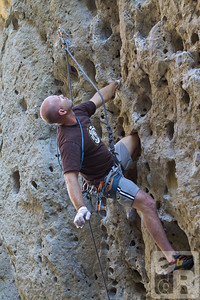 Using a knee bar, Clif looks for his next hold