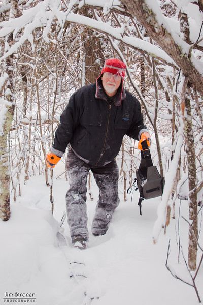 Image of Dr. Lynn Rogers on his way to install a camera in Lily's den December 2010.
