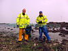 Fisherman and shore gatherer Alan Ozanne and Andy return from the lower shore of Belle Greve Bay on Guernsey's east coast with their harvest of ormers, Haliotis tuberculata, during a big low spring tide on the 17 April 2007.<br /> File No. BG 170407 7967<br /> ©RLLord<br /> fishinfo@guernsey.net