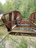 The iron structure is all that is left of a bridge over the Chestatee river at the Copper Mine, Dahlonega, Ga. He climbs trees, he climbs rock and climbs bridges. Arborwear Tech pants even held up to this challenge - to get to the other side of the river without getting wet.  September 2006.