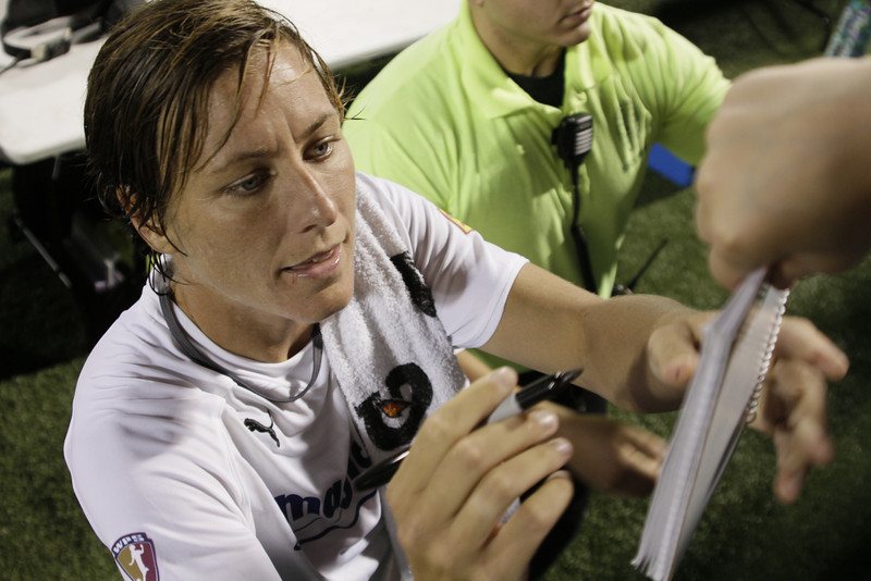 Abby signing autographs after the game.