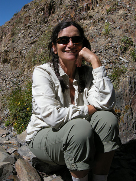 Michèle among black and slatey rocks of the Goodard and Kings Terranes, geological units in the area.