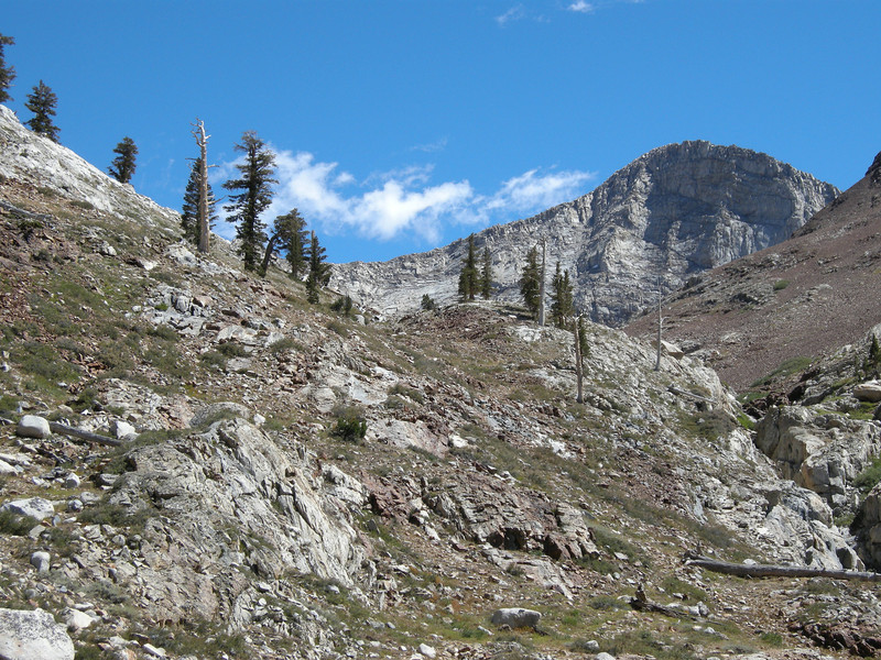 Looking back at the now-towering face of Florence Peak, a few wisps of clouds began appearing.