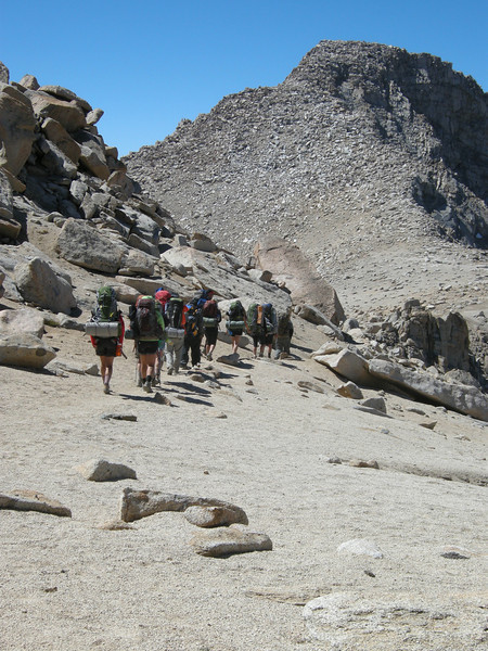 The San Diego bunch starts their descent down the west side, with the slope of Florence Peak beyond. Though it may look intimidating, the scramble up Florence Peak along that side is only Class Two with a smattering of Class Three.