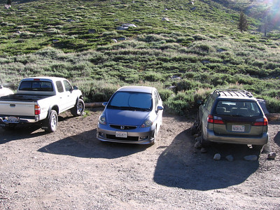 The Fit in the Timber Gap/Sawtooth Pass trailhead area. Marmots have been known to munch on cars here; note that the Subaru to the right of our Fit has chicken wire and boulders around it to hopefully fend off the pests. I trusted that the Fit, having low ground clearance and tight hood space with no coolant leaks, would not be an attractive rodent target.