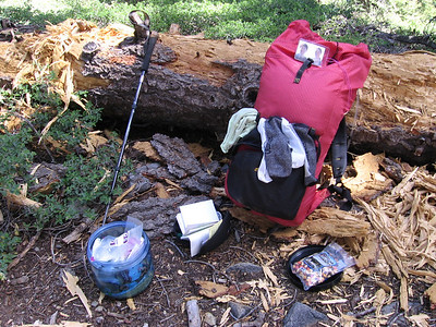 """Rest stop just above Cliff Creek. Trader Joe trailmix, yum. Note photo of """"The Girls"""" on my pack."""