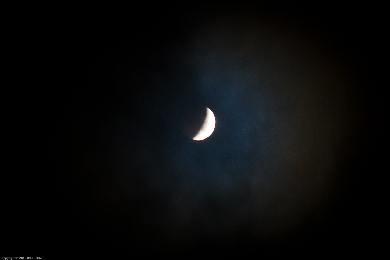 12/21/10 Eclipse at 02:14 AM Through cloud cover and a dirty skylight