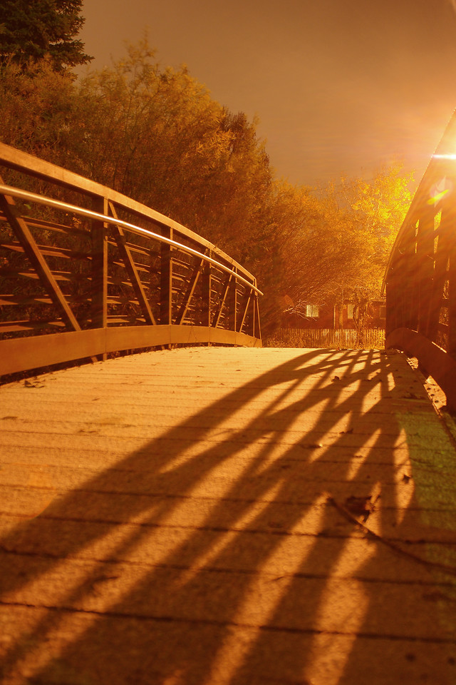 A bridge on the Gallagator Trail lit by street light.  Bozeman, MT<br /> <br /> © Kirk Sagers