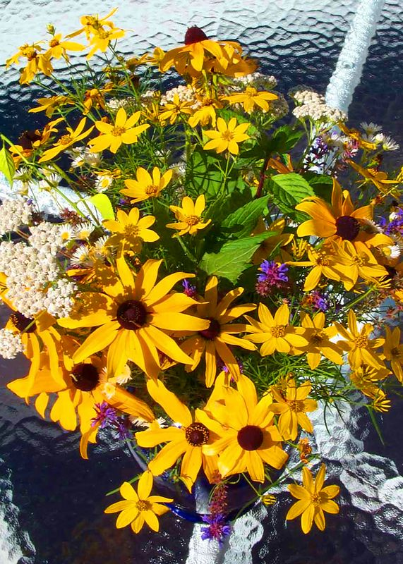 Mixed flowers on glass table