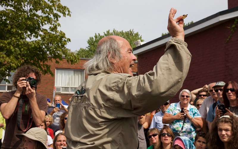 Georges Brossard, founder of The Montreal Insectarium, releasing a monarch butterfly