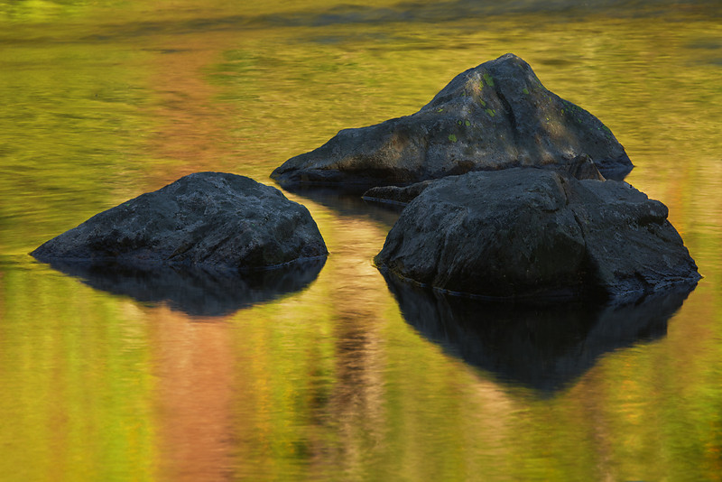Brilliant reflected colors around shaded rocks, Outlet from Painted Lake, south Hilgard Basin, Lee Metcalf Wilderness, MT
