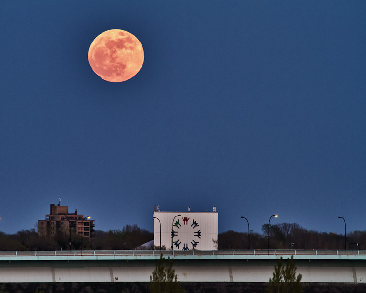 "The May 5th ""super moon"" of 2012 rises above the Man and His World sign from the Expo 67 World's Fair in Montreal, Quebec, Canada"